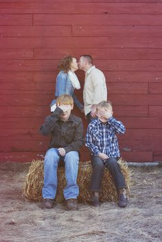 Funny country style family portrait session | Red barn and hay | © Lucy Dennis Photography