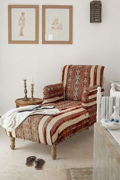 Cool white room with a kilim upholstered lounge chair, in Hotel Villa Maroc, Essaouira.