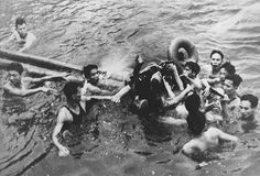 An airman being captured by Vietnamese in Truc Bach Lake, Hanoi in 1967. The airman is John McCain.