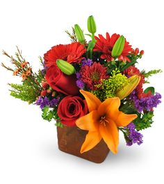 Our Fruit Of The Bloom™ bouquet is so chock-full of mouth-watering hues,  it almost looks good enough to eat! A rainbow of vibrant, sun-ripened  shades - such as tangerine-tinted Asiatic lilies, raspberry-red roses,  and strawberry-shaded gerbera daises - will dazzle and delight the lucky  recipient of this brilliant bouquet. Sure to make anyone's day just  peachy!   A colorful mix of roses, mini gerbera daisies, Asiatic lilies,  chrysanthemums, bupleurum, hypericum berries, purple statice…