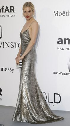 Stunning in silver: Sienna Miller looked a treat in her Ralph Lauren metallic dress when she arrived at the amfAR Gala near Cannes on Thursday evening