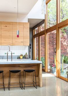 love the clean lines, wood and wall of windows!