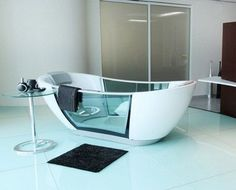 No effing way. I want one. Smart Hydro smart bathtub keeps your bathwater from getting cold and cleans itself!