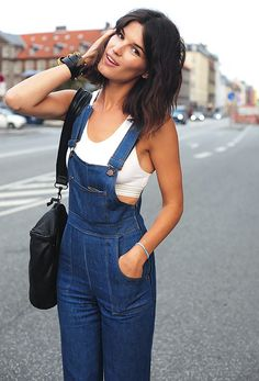 Sports bra worn underneath denim overalls