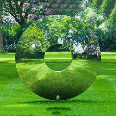 Polished round stainless steel sculpture garden decor