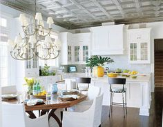Love this kitchen, particularly the tin ceiling