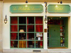 Entrance of Le Relais du Louvre, a character hotel in the center of Paris. http://relais-du-louvre-paris.com/