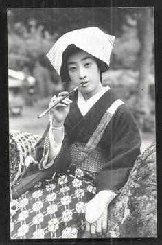 kikikimono Postcard of farmer girl smoking pipe- Japan 1920s