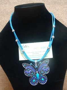 Butterfly idea.... beads put on a ready made pendant