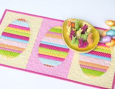 = free pattern = Easter egg table runner by She Quilts a Lot, featured at Quilt Inspiration