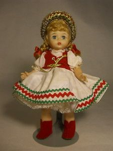 I had a doll like this when I was a kid. She had brown hair though . . .