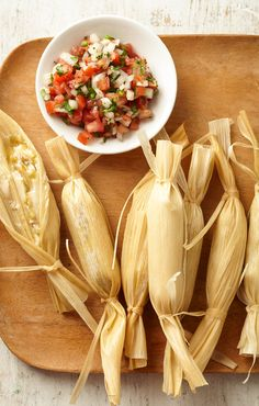 Tamales just might be the most important part of creating a traditional Mexican Christmas dinner. Because tamales take a little extra kitchen energy, they're generally saved for special occasions, such as the holidays. #mexicanchristmasdinner #mexicandinnerrecipes #easyrecipes #christmasdinnerideas #bhg