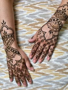 Henna on hands inspired by kid gloves and armor.