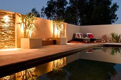 Modern low maintenance pool area - feature walling & built in bench seating