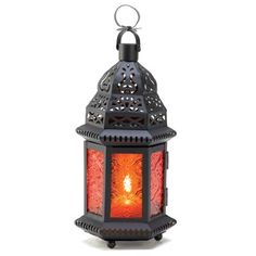 Sunset orange adds lovely color to this pressed glass and metalwork candle lantern. A dramatic display of light and shadow that enhances any living space! Loop at top for hanging.