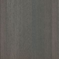 An allover dark grey coloured oak wood grain in straight grain with deep sand coloured undertones.