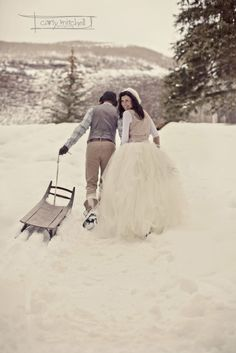 if I had a winter wedding, I would TOTALLY go sledding in the dress.