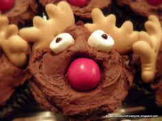 Reindeer Cupcakes - upside down animal crackers for antlers!