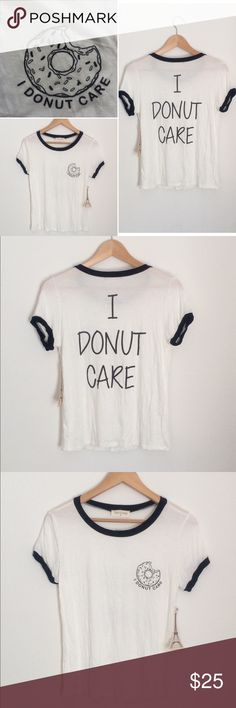 I DONUT CARE Tee White/Black Size M/L ACCEPTING OFFERS!!. Not Brandy Melville. Listed for exposure. No low ballers. No trades. New with tag. Large will fit a medium and a large (will be tighter). Be advised when purchasing specific size. DO NOT COMMENT INAPPROPRIATE COMMENTS. Wholesale brand. Brandy Melville Tops Tees - Short Sleeve