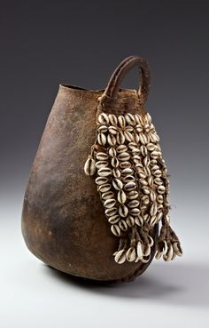 Milk bucket from the Borana people of Kenya, Africa.  Hide, fiber and cowrie shells, ca. 1950 - 1980