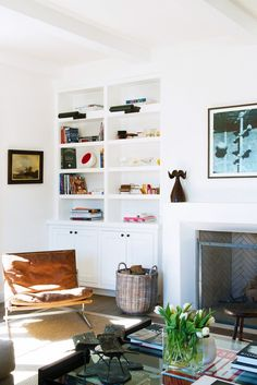 White living room with styled shelves