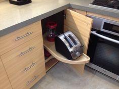 Under cabinet swiveling appliance storage dolly.