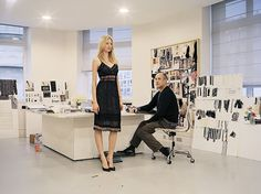 Peter Copping for Nina Ricci in his Paris studio with a model in a silk lace dress from the Fall/Winter 2012 ready-to-wear collection.