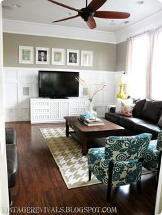 Batten board wall, neutral putty color paint, pops of turquoise and the five pictures in a row