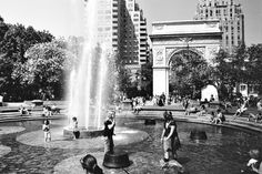 SUMMER WATER FOUNTAIN  People enjoying the fountain at Washington Square during a summer heatwave.