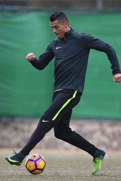 Cristiano Ronaldo wearing Nike Mercurial Superfly V Cr7 AG-Pro Soccer Cleats, Nike Dry Strike Soccer Pants in Black/Volt and Nike Aerolayer Repel Strike Drill Long Sleeve Soccer Top