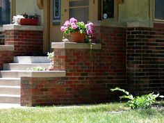 My recent post about the trouble with the downspout and pavement at the front of the house reminded me of another topic I haven't posted on yet: the front steps. Although I don't have a…