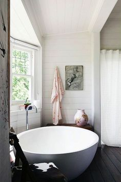 The dreamiest freestanding bathtub surrounded by crisp, white shiplap walls.