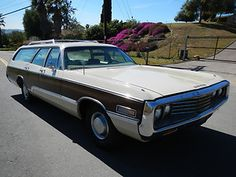 1970 Chrysler Town & Country Wagon - the glory days! My folks had one of these. I have a 2009 Chrysler Town & Country but it's a minivan.