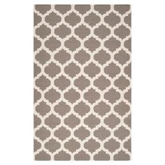 Stylishly anchor your living room or master suite with this lovely hand-woven wool rug, showcasing a quatrefoil trellis motif in taupe and white.  ...