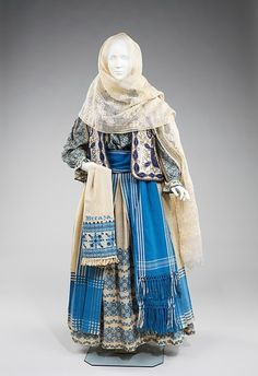 A Romanian folk costume dating from the late 19th century.  Metropolitan Museum of Art  The embroidery on the shawl says Breaza, which is a town in central Romania.
