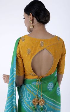 blouse designs Description: Green-Yellow Bandhej Saree on Pure Georgette Combined with zardozi handwork blouse Gota detail border all-over the Saree with Gota tassels on the pallu edges Blouse Back Neck Designs, Stylish Blouse Design, Fancy Blouse Designs, Blouse Neck, Latest Blouse Designs, Indian Blouse Designs, Corset Blouse, Silk Saree Blouse Designs, Designer Saree Blouses
