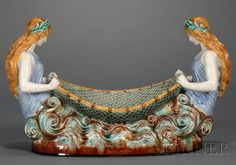 Wedgwood Majolica Naiad Centre Bowl, England, c. 1870, polychrome decorated and modeled with a net form bowl supported by maidens atop a wave base, impressed mark, lg. 17 1/2 in. | SOLD $7,110