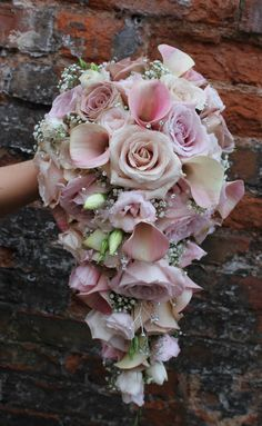 teardrop bridal bouquet in muted lilac and nude pink tones - quicksand rose- amnesia rose - 'captain marrero' calla lily - lisianthus - gypsophila