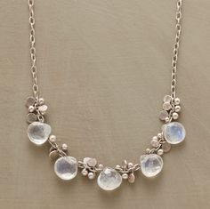 "moonstone and paillettes of hammered sterling glisten on a light sterling chain. Lobster clasp. Handmade in USA. 16""L."
