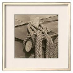 <p>Add a dash of costal style to your home decor with the Nautical Aspect IV wall art from art.com. Printed on acid-free paper, this elegant photograph by Michael Kahn offers a close-up of a ship's ropes tied to a dock. The sepia-toned photo offers a stylish vintage-vibe. Available as a 12x12 art print or an 18x18 framed print with a beautiful soft white mat and felt backing.</p>