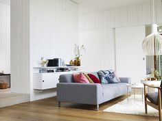 A white Octo 4240 by Secto Design brightening up the living room.