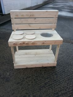 Basic mud kitchen constructed from reclaimed pallet wood & ply discs