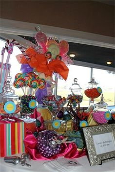 A whimsical centerpiece pulled this bright colored candy bar together.