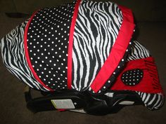 Graco Snugride Infant Car Seat Cover Black and White Zebra and Red Minky Dot. $109.99, via Etsy.