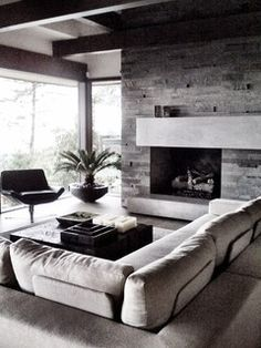 Stone off-center fireplace with long mantel.  Perfect for the basement remodel