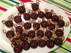 Donut Reindeer...  choc donut, pretzels, green icing for the eyes,  red mm
