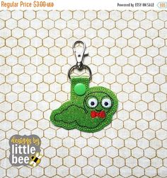 """❘❘❙❙❚❚ ON SALE ❚❚❙❙❘❘   **THIS IS NOT A PATCH, SHIRT, OR A PHYSICAL ITEM.** This is a design to be used with an embroidery machine.  Files are included to create this snap tab! At 3.5"""" long, this snap tab fits snugly in your 4x4 hoop!  The following formats are included in this listing: PES, DST, EXP, HUS, JEF, VIP, VP3, and XXX. You may download your embroidery file immediately after your etsy purchase.   Love my embroidery designs? Visit my Facebook group to snoop for freebies or coupo..."""