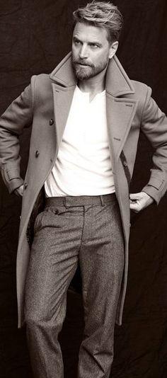 Dapper men's fashion. Male model wearing trousers, coat, and shirt