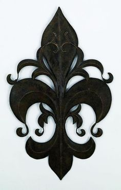 This Tuscan Burnished Green-Brown-Gold Fleur de Lis Wall Plaque is the perfect wall #decor for over a fireplace mantel, in a bedroom, living room or home office. The striking #walldecor features a burnished green-brown finish forged by master craftsmen of iron and tole. It is hand made, hand crafted and hand painted in a multi-step process.