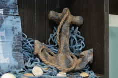 Create an anchor out of cardboard and foil. Fun, easy, inexpensive beach decor!